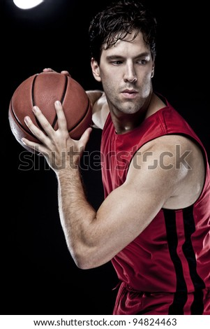 Basketball player with a ball - stock photo