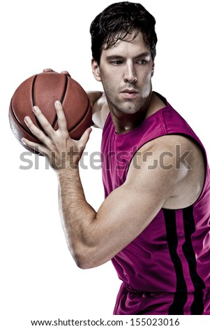 Basketball player with a ball in his hands and a Pink uniform. On a white Background