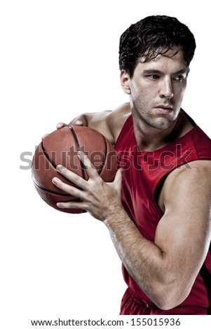Basketball player with a ball in his hands and a red uniform. On a white Background