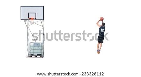 basketball player with black jersey shooting at the hoop. - stock photo