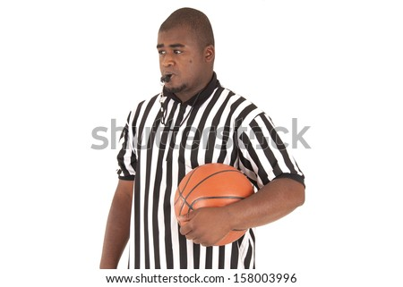 Basketball referee with ball blowing the whistle - stock photo