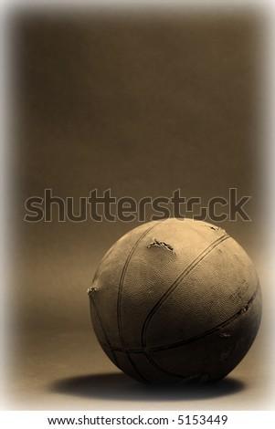 basketball  resting on the floor - stock photo
