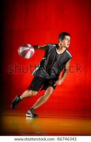 Basketball run on red background - stock photo