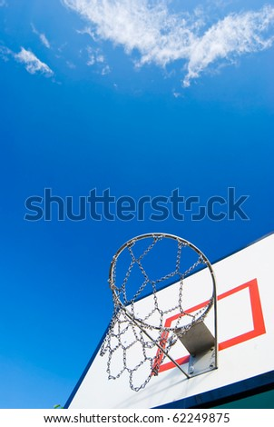 Basketball stands under blue sky  in sunny dy