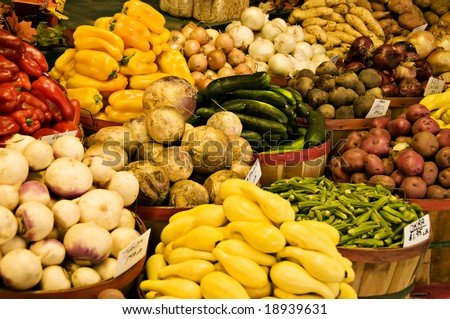 Baskets of Vegetables being displayed at a farmer's market. - stock photo