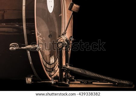 bass drum with pedal, musical instrument on black background - stock photo