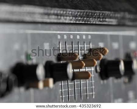 Bass guitar amplifier closeup, focus on equalizer, for music,entertainment - stock photo