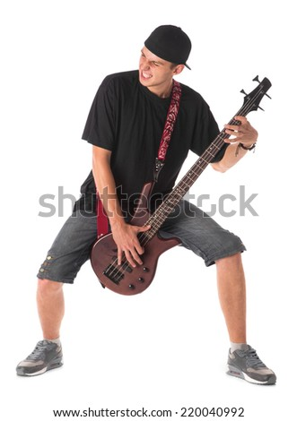 Bass guitarist. Isolated on the white background.