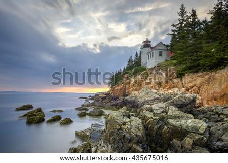 Bass Harbor Head Light in Acadia National Park, Maine at sunset. - stock photo