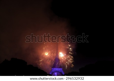 BASTILLE DAY 2015 in Paris, France on July 14th, 2015. Fireworks and the Eiffel tower on the French National Day in Paris, France on July 14th, 2015, from Field of Mars (Champ de Mars)