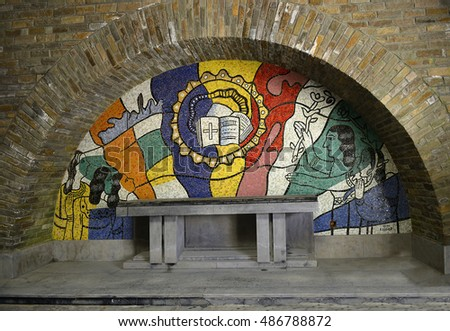 BASTOGNE, BELGIUM - AUGUST 25, 2016: The crypt with the mosaics by Fernand Leger of Mardasson military memorial commemorating american casualties of battle of the bulge at the end of second world war