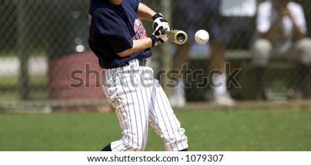 bat about to hit ball - stock photo