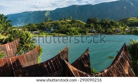 batak houses on samosir island which is located on lake toba in sumatra, indonesia - stock photo