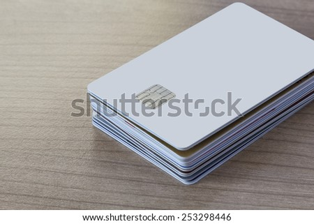 Batch of Credit or debit Cards on a wooden table - stock photo