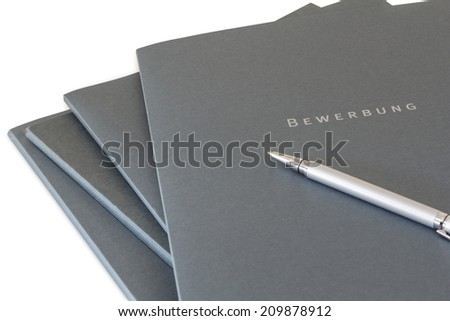 Batch of job application files and a silver pen isolated on white background