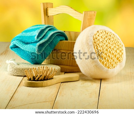 bath accessories on wooden table on green background - stock photo