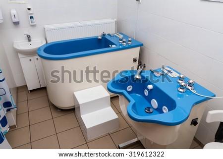 bath at physiotherapy clinic, horizontal - stock photo