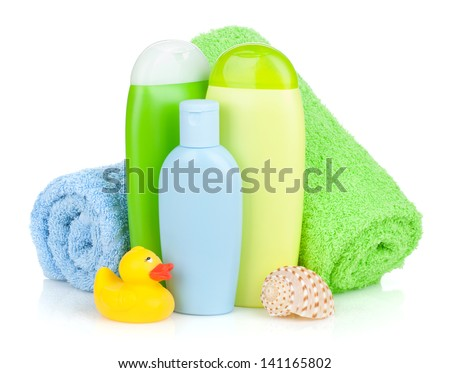 Bath bottles, towel and rubber duck. Isolated on white background - stock photo