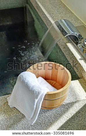 Bath bucket with a towel at a hot spring bath at Japanese onsen                     - stock photo