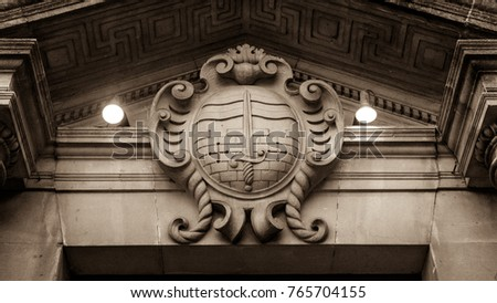 Bath Coat of Arms, English Crest of Bath, Plaque on Stone Wall, Vintage Keystone in Doorway, Architecture Detail in Sepia Tone low angle