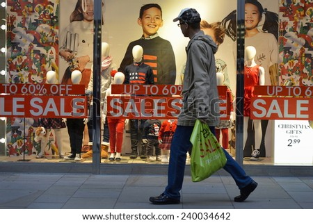 BATH - DEC 25: People visit stores in Southgate shopping district for the Boxing Day Sales on Dec 25, 2014 in Bath, UK. Many shops across the country traditionally hold sales on Boxing Day.    - stock photo