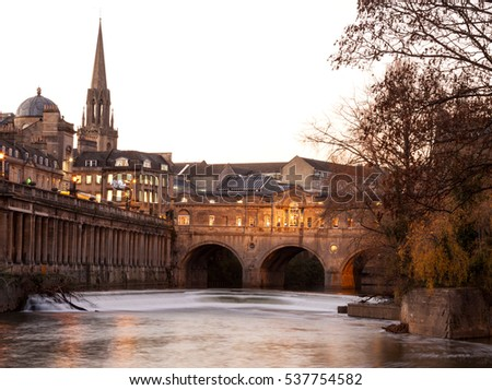 Bath, England: Avon River and Pulteney Bridge illuminated at dusk.