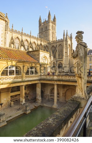 BATH, ENGLAND - FEB 18, 2013: The Ancient Roman Baths, with visitors, in Bath, Somerset, England