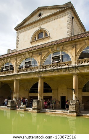 BATH, ENGLAND - JULY 10: Ancient Roman Bath Museum, which receives over 1 million visitors a year on July 10, 2013 in Bath, England