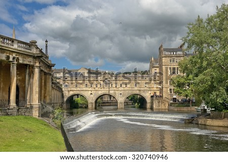 BATH, ENGLAND - JULY 28: Pulteney Bridge (designed by Robert Adam) over the River Avon on July 28, 2015 in Bath, England - stock photo