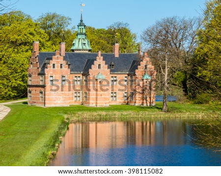 Bath House - charming building is situated in romantic English-inspired garden, Frederiksborg Castle, Hillerod, Denmark - stock photo