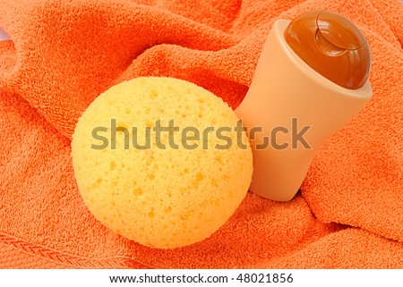 Bath items for shower on the orange towel - stock photo