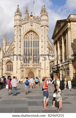 BATH - JULY 26: Tourists and locals enjoy a sunny day in the courtyard of the historic Bath Abbey and Roman Baths on July 26, 2010 in Bath, UK. Bath receives 4.5M visitors a year. - stock photo