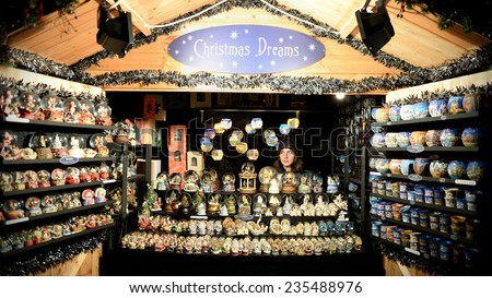 BATH - NOV 30: View of a Christmas market booth in the streets surrounding Bath Abbey on Nov 30, 2014 in Bath, UK. The market has become an annual fixture for the historic Unesco World Heritage City. - stock photo