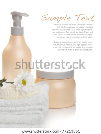 Bath products and flower on soft white towels against white background (spa, hotel, bathing concept and more)