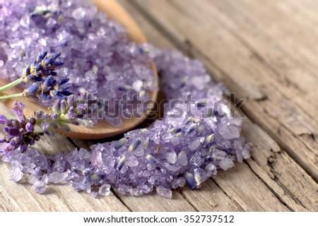 Bath salt with fresh lavender on weathered wood  - stock photo