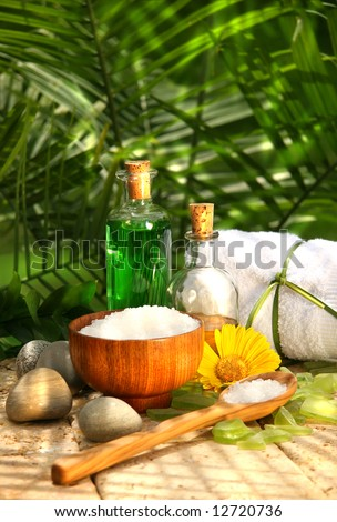 Bath salts and essential oils for a relaxing spa moment - stock photo