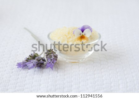 Bath salts and lavender over white towel background