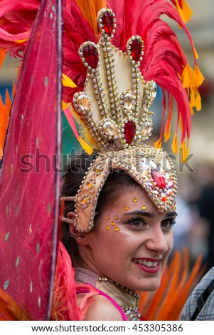 BATH, SOMERSET, UK - JULY 16 2016  Head and feathers of dancer at Bath Carnival. Bath Carnival procession around the streets of Bath, bringing a South American festival atmosphere to Somerset