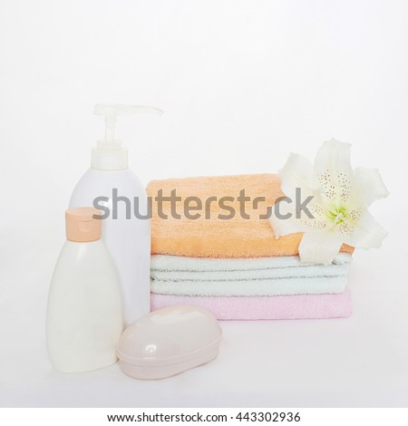Bath still life.towels, flower and cosmetics - stock photo