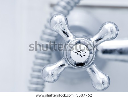 Bath tap with hot sign  close up - stock photo