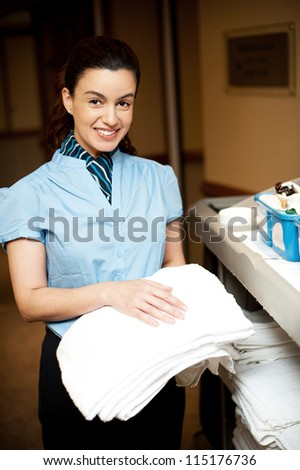 Bath towels are ready to be delivered by the housekeeping executive - stock photo