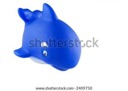 bath toy, blue rubber killer whale (orca) - stock photo