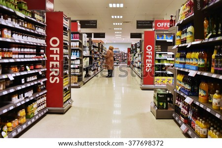 BATH, UK - FEB 10, 2015: Aisle view in a Waitrose supermarket. Founded in 1904 Waitrose is the food retail division of the John Lewis Partnership, Britain's largest employee owned retailer.
