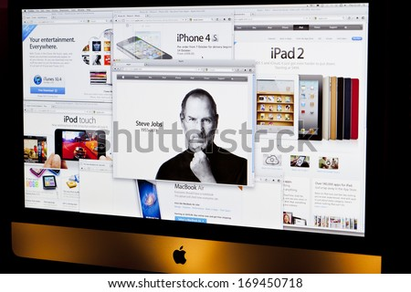 BATH, UK - OCTOBER 6, 2011: An Apple iMac displaying several browser windows relating to Apple products and the front page tribute to former chief executive Steve Jobs, who died on 5th October 2011.