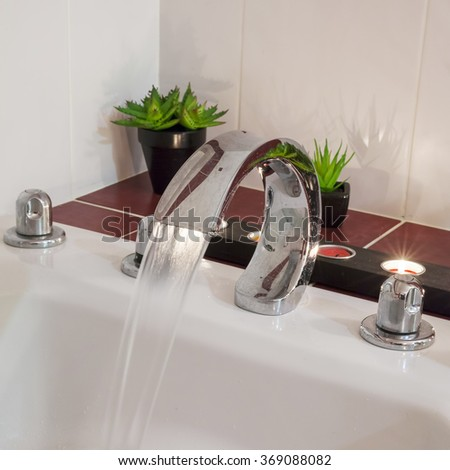 bath with water candles and plants - stock photo