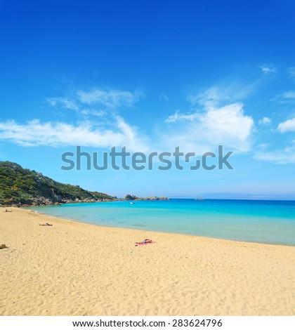bathers in Rena Bianca shore, Sardinia - stock photo
