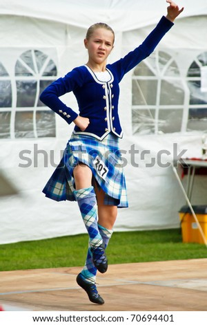BATHGATE, SCOTLAND - CIRCA MAY 2009: An Unidentified Scottish girl dancer performs a traditional dance circa May 2009 during a Highland games competition held in Bathgate, Scotland. The event is held annually. - stock photo