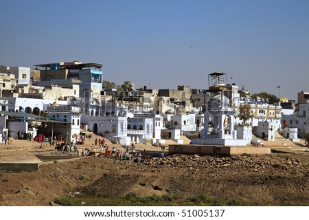 bathing ghats in Pushkar,India. Pushkar is one of the oldest cities of India and one of the five sacred dhams (pilgrimage sites for devout Hindus).