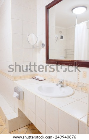 Bathroom cabinet with white sink and large mirror