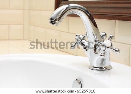 Bathroom closeup - sink, faucet and tile - stock photo